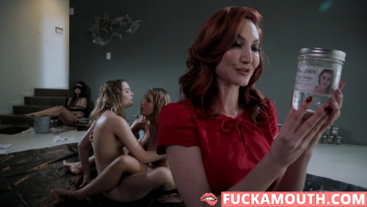 redhead mistress and her two submissive girls
